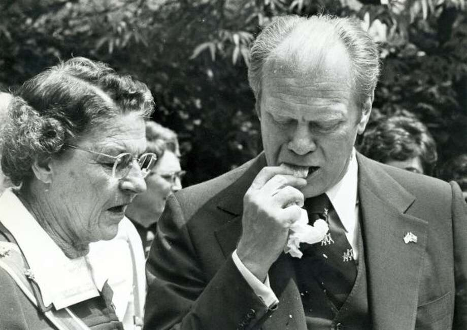 Gerald Ford — In San Antonio, Ford will always be remembered for trying to eat a tamal with the husk on — in front of the Alamo, no less. A favorite family dish was German Apple Pancakes. Photo: (PAT HAMILTON / Express-News File Photo)