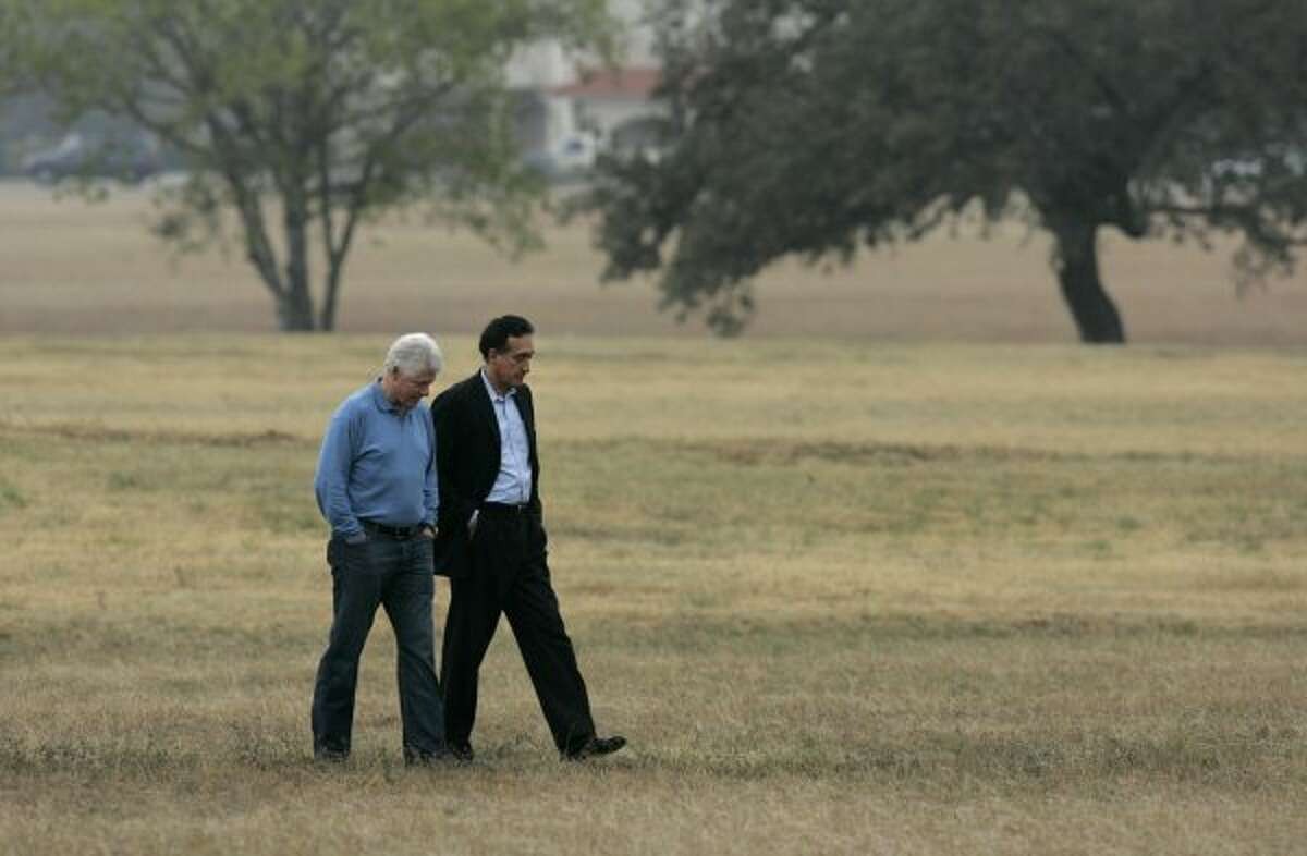 Former President Bill Clinton and Henry Cisneros, former mayor of San Antonio and former Secretary of Housing and Urban Development under President Clinton, walk on the grounds of Palo Alto College after speaking at a rally in support of Ciro Rodriguez, Democratic candidate Texas' 23rd Congressional District, in San Antonio on Sunday, December 10, 2006. (LISA KRANTZ / SAN ANTONIO EXPRESS-NEWS)