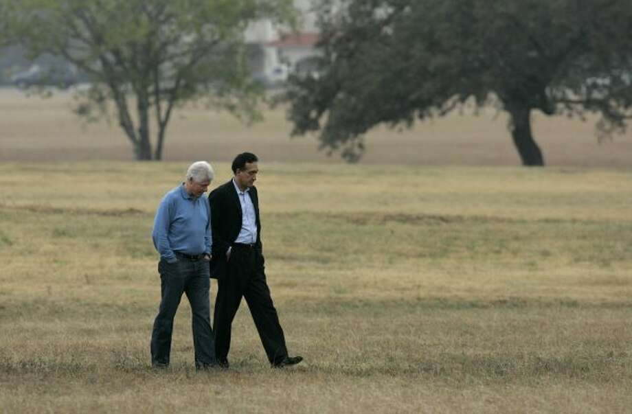 Former President Bill Clinton and Henry Cisneros, former mayor of San Antonio and former Secretary of Housing and Urban Development under President Clinton, walk on the grounds of Palo Alto College after speaking at a rally in support of Ciro Rodriguez, Democratic candidate for Texas' 23rd Congressional District, in San Antonio on Sunday, Dec. 10, 2006.