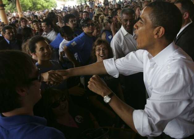 Then presidential candidate, Barack Obama greeted supporters after a speech at Sunset Station, June 21, 2007.  (JERRY LARA / SAN ANTONIO EXPRESS-NEWS)