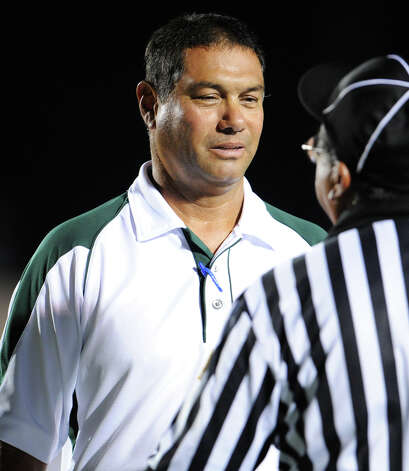 Holmes head football coach Hector Rodriguez talks to an official during a District 28-5A football game between the Holmes Huskies and Marshall Rams at Gustafson Stadium in San Antonio, Texas on September 24, 2010  John Albright / Special to the Express-News. Photo: JOHN ALBRIGHT, San Antonio Express-News / San Antonio Express-News