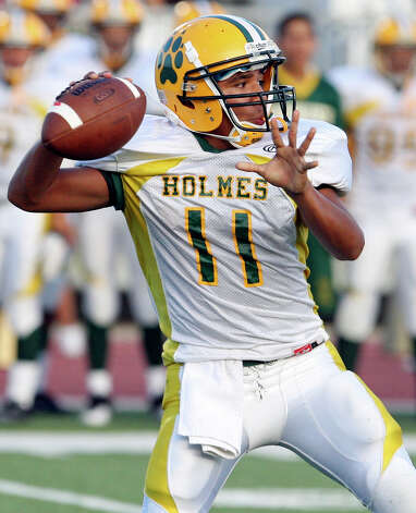 FOR SPORTS - Holmes' Gilbert Garcia passes against Brennan during first half action Thursday Aug 25, 2011 at Gustafson Stadium.  (PHOTO BY EDWARD A. ORNELAS/eaornelas@express-news.net) Photo: EDWARD A. ORNELAS, SAN ANTONIO EXPRESS-NEWS / © SAN ANTONIO EXPRESS-NEWS (NFS)