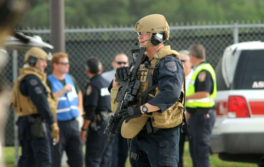 Harris County Sheriff's Office Swat Team members respond to a simulated explosion at Humble ISD's Turner Stadium as part of a recent training session with more than 20 local and federal law enforcement and emergency response agencies. Photo: Jerry Baker