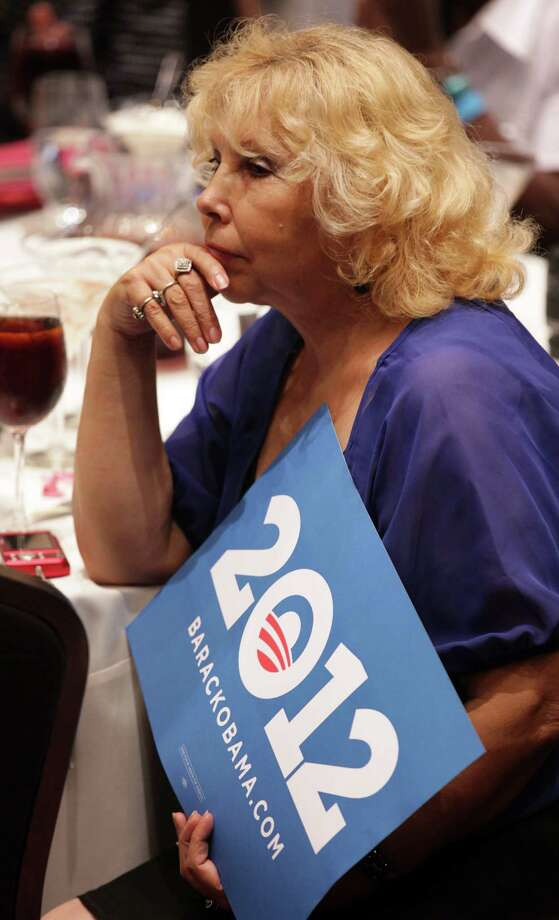 A supporter listens to President Barack Obama speaks at a fund raiser in San Antonio, TX, at the Henry B. Gonzalez Convention Center, July 17, 2012. Photo: Bob Owen / © 2012 San Antonio Express-News