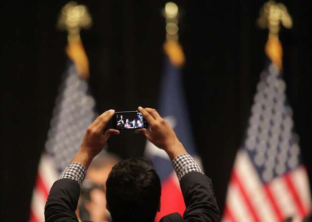 A supporter of President Barack Obama takes a photo of the president as he leaves a fund raiser in San Antonio, TX, at the Henry B. Gonzalez Convention Center, July 17, 2012. Photo: Bob Owen / © 2012 San Antonio Express-News
