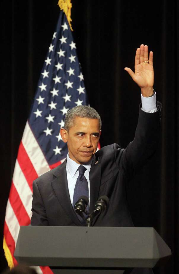 President Barack Obama gives a wave to the crowd as he finished speaking at a fundraiser in San Antonio, TX, at the Henry B. Gonzalez Convention Center, July 17, 2012. Photo: Bob Owen / © 2012 San Antonio Express-News