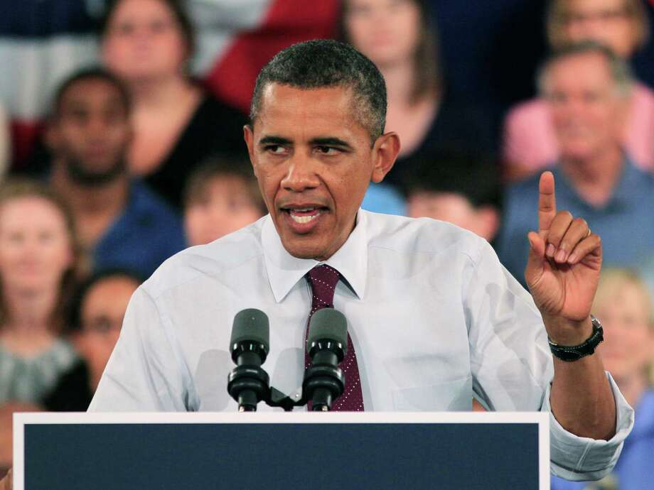 President Barack Obama makes a point during a town meeting on July 16 at Music Hall in Cincinnati. Photo: Al Behrman, AP / AP