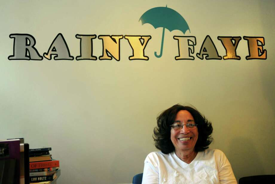 Rainy Faye Bookstore owner Dr. Georgia Day at her shop at 1042 Broad Street in Bridgeport, Conn. on Tuesday July 17, 2012. Day is planning to close the store on August 1st. Photo: Cathy Zuraw / Connecticut Post