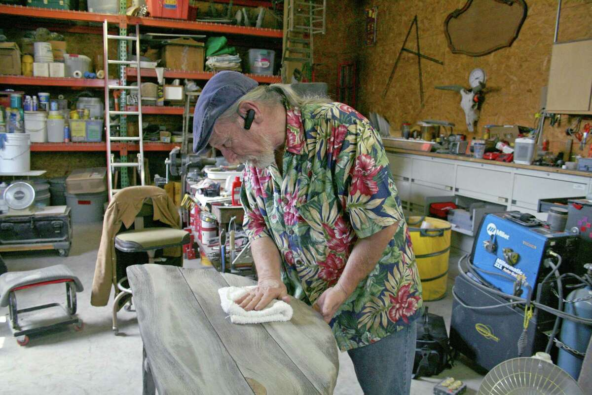 Donald Tucker, 67, creates art using an old-time technique in which cement is made to resemble wood.