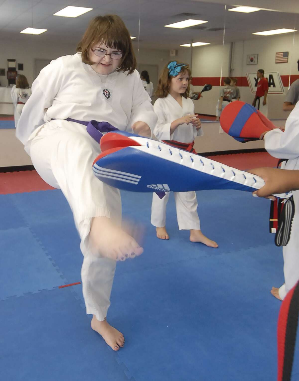 Aryn Romero practices her taekwondo moves in a class at Apex Taekwondo Monday 5/07/12. Photo by Tony Bullard.