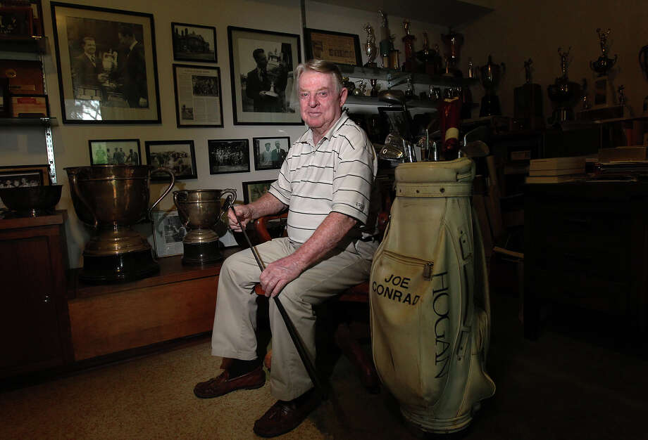 Joe Conrad, 82, won the British Amateur Championship in 1955 at Royal Lytham and St. Anne's. This year's British Open will played at the same course this week. Conrad honed his golfing skills at Brackenridge, Riverside and Willowsprings as a junior player. After playing for the American Walker Cup Team in 1955 where he lost his singles match despite America's overall win, Conrad was determined to play better at the British Amateur. Competing against 248 other players in match play, then 25-year-old Conrad surprised the field and eventually won. On the walls of his home, Conrad keeps photos of his victory at the British Amateur along with various other trophies from his many wins on the golf course. Conrad now helps to supply junior golfers with clubs to play the game he so loves. Photo: Kin Man Hui, San Antonio Express-News / © 2012 San Antonio Express-News