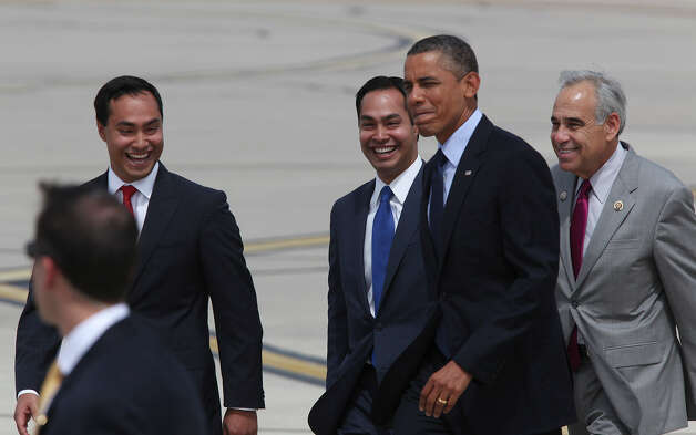 U.S. President Barack Obama walks with St. Rep. Joaquin Castro, left, Mayor Julian Castro and U.S. Congressman Charlie Gonzalez upon his arrival at San Antonio International Airport, Tuesday, July 17, 2012. Obama is attending two fundraising events, one at the Convention Center and another one at a private residence in the Dominion. Photo: Jerry Lara, San Antonio Express-News / ¨ 2012 San Antonio Express-News