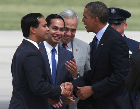 U.S. President Barack Obama greets the Castro brothers, state Rep. Joaquin Castro, left, and Mayor Julian Castro upon his arrival at San Antonio International Airport, Tuesday, July 17, 2012. Obama is attending two fundraising events, one at the Convention Center and another one at a private residence in the Dominion. Behind them is U.S. Congressman Charlie Gonzalez. Photo: Jerry Lara, San Antonio Express-News / © 2012 San Antonio Express-News