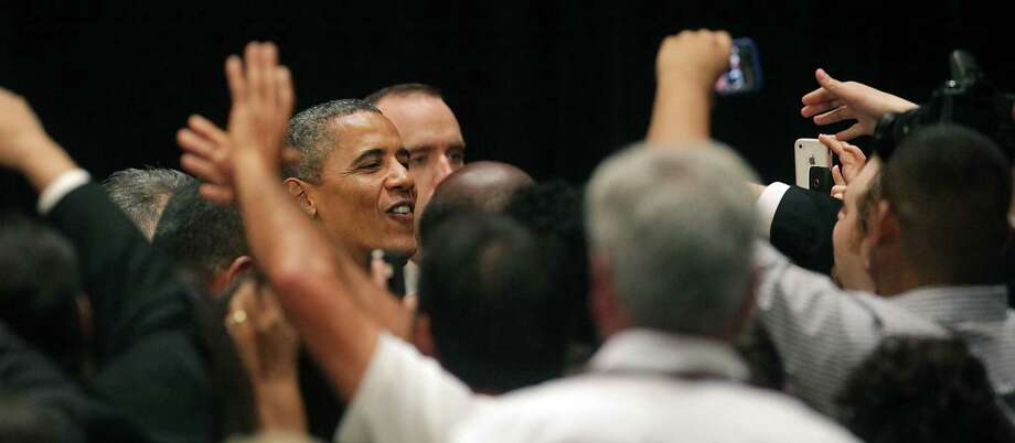 President Barack Obama works the crowd at a fund raiser in San Antonio, TX, at the Henry B. Gonzalez Convention Center, July 17, 2012. Photo: Bob Owen, San Antonio Express-News / © 2012 San Antonio Express-News