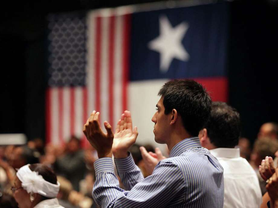 An unidentified supporter of President Barack Obama shows his appreciation for the president, as he speaks at a fund raiser in San Antonio, TX, at the Henry B. Gonzalez Convention Center, July 17, 2012. Photo: Bob Owen, San Antonio Express-News / © 2012 San Antonio Express-News