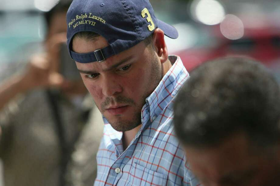 Antonio Pena is lead from police headquarters on Tuesday July 17, 2012.  Pena is one of three men being charged with burglary with intent to commit a felony-retaliation after being arrested following a stand off on Tuesday. Photo: Helen L. Montoya, San Antonio Express-News / ©SAN ANTONIO EXPRESS-NEWS