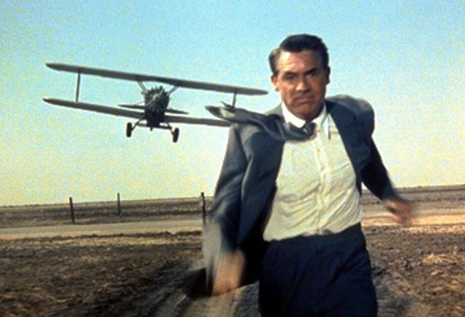 """North By Northwest"" (1959): Cary Grant is on the run from a crop duster in a scene from Hitchcock's tale of mistaken identity. Photo: Courtesy Texas Public Radio / Copyright © Courtesy Everett Collection / Everett Collection"