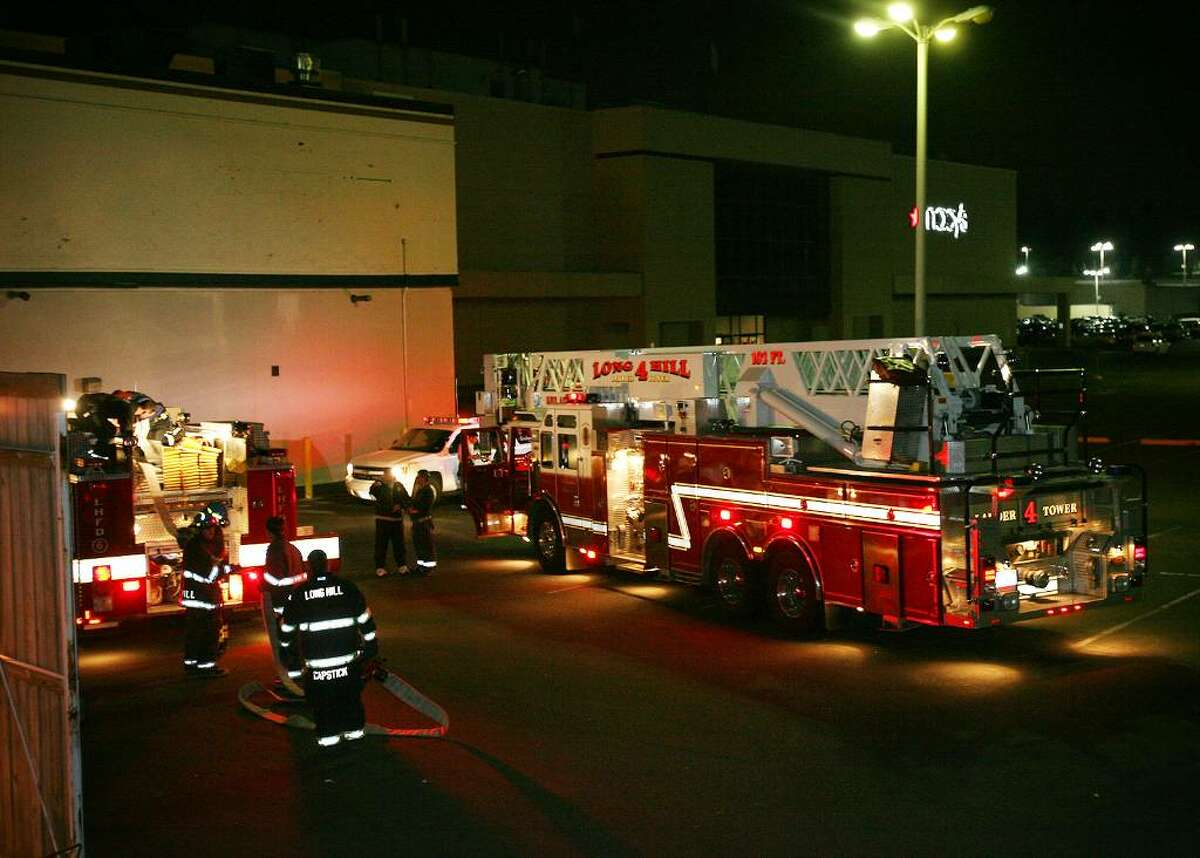 Trumbull firefighters respond to the Trumbull mall, Sunday evening due to a burning smell from an HVAC unit at the Wet Seal store.