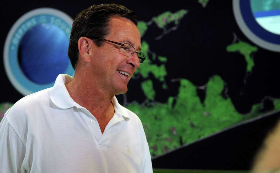 Governor Dannel Malloy takes a tour of the Maritime Aquarium in Norwalk to promote state tourism destinations. Photo: Lindsay Niegelberg / Stamford Advocate