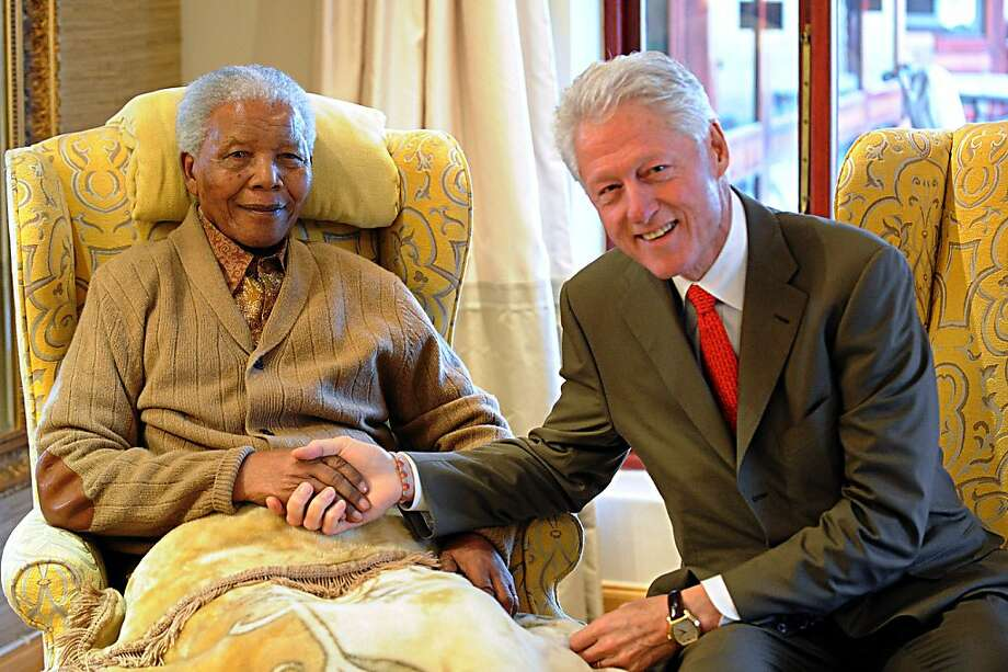 """Former US President, Bill Clinton (R) pays a visit to former South African President Nelson Mandela on July 17, 2012 at his home in Qunu, Eastern Cape, on the eve of his 94th birthday. AFP PHOTO/PETER MOREY/FOR 48 HOURS USE ONLY/ SOUTH AFRICA OUT/ NO INTERNET - NO MAGAZINES- NO ARCHIVES RESTRICTED TO EDITORIAL USE - MANDATORY CREDIT """"AFP PHOTO/PETER MOREY""""- NO MARKETING NO ADVERTISING CAMPAIGNS - DISTRIBUTED AS A SERVICE TO CLIENTS  PETER MOREY/AFP/GettyImages Photo: Peter Morey, AFP/Getty Images"""
