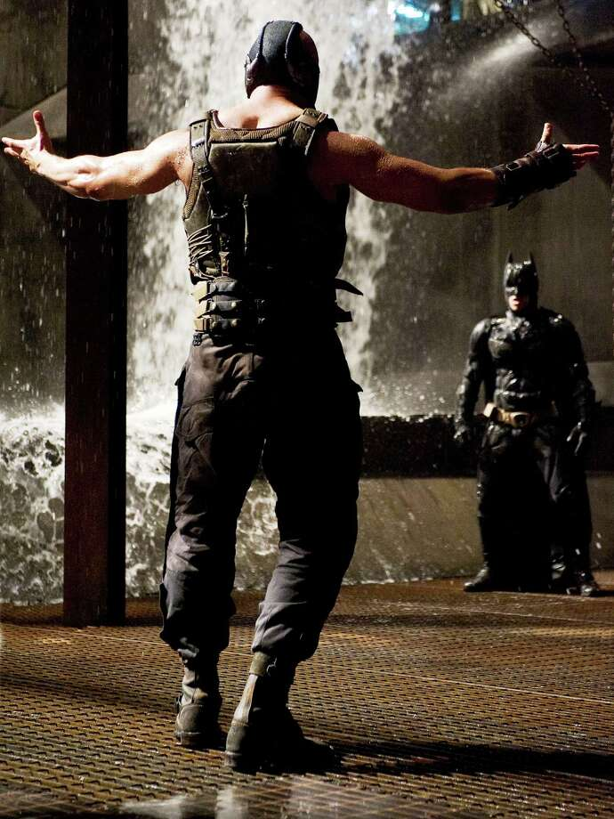 L-r: TOM HARDY as Bane and CHRISTIAN BALE as Batman in THE DARK KNIGHT RISES Photo: Ron Phillips, Warner Bros. Pictures / © 2012 WARNER BROS. ENTERTAINMENT INC. AND LEGENDARY PICTURES FUNDING, LLC