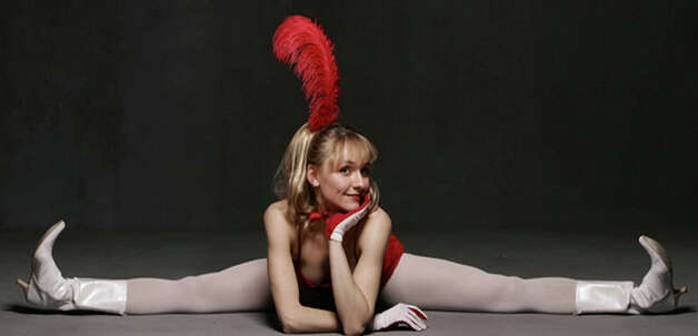 Contortionist and aerial artist Miss Ekaterina will be coming to Westport's Levitt Pavilion for the Performing Arts as part of the Bindlestiff Family Cirkus. This family friendly performance will begin at 7 p.m., Wednesday, July 25, 2012. For ticket information, visit http://levittpavilion.com or call 203-226-7600.  Contributed photo/Jim R. Moore Photo: Contributed Photo