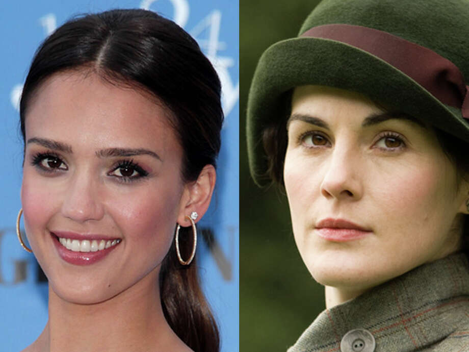 "It's got to be the costume roles they've played. ""Fantastic Four"" star Jessica Alba looks like a teen compared to Michelle Dockery in her staid ""Downton Abbey"" wardrobe. Both were born in 1981. Photo: Wire"
