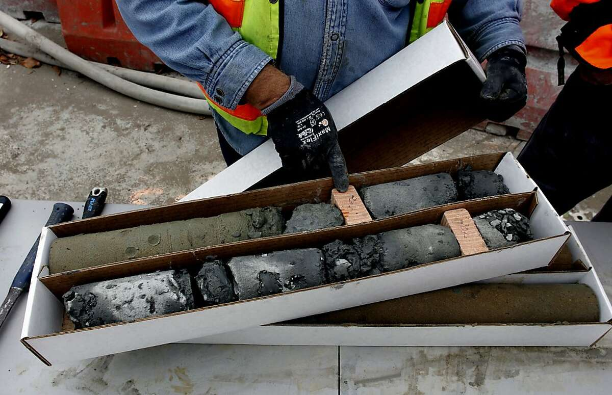 Glenn Schmidtberger, jet grout supervisor, collects core sample for analysis at the Central Subway project through downtown San Francisco, Calif., along Fourth Street, between Harrison and Bryant Streets, on Friday July 13, 2012.