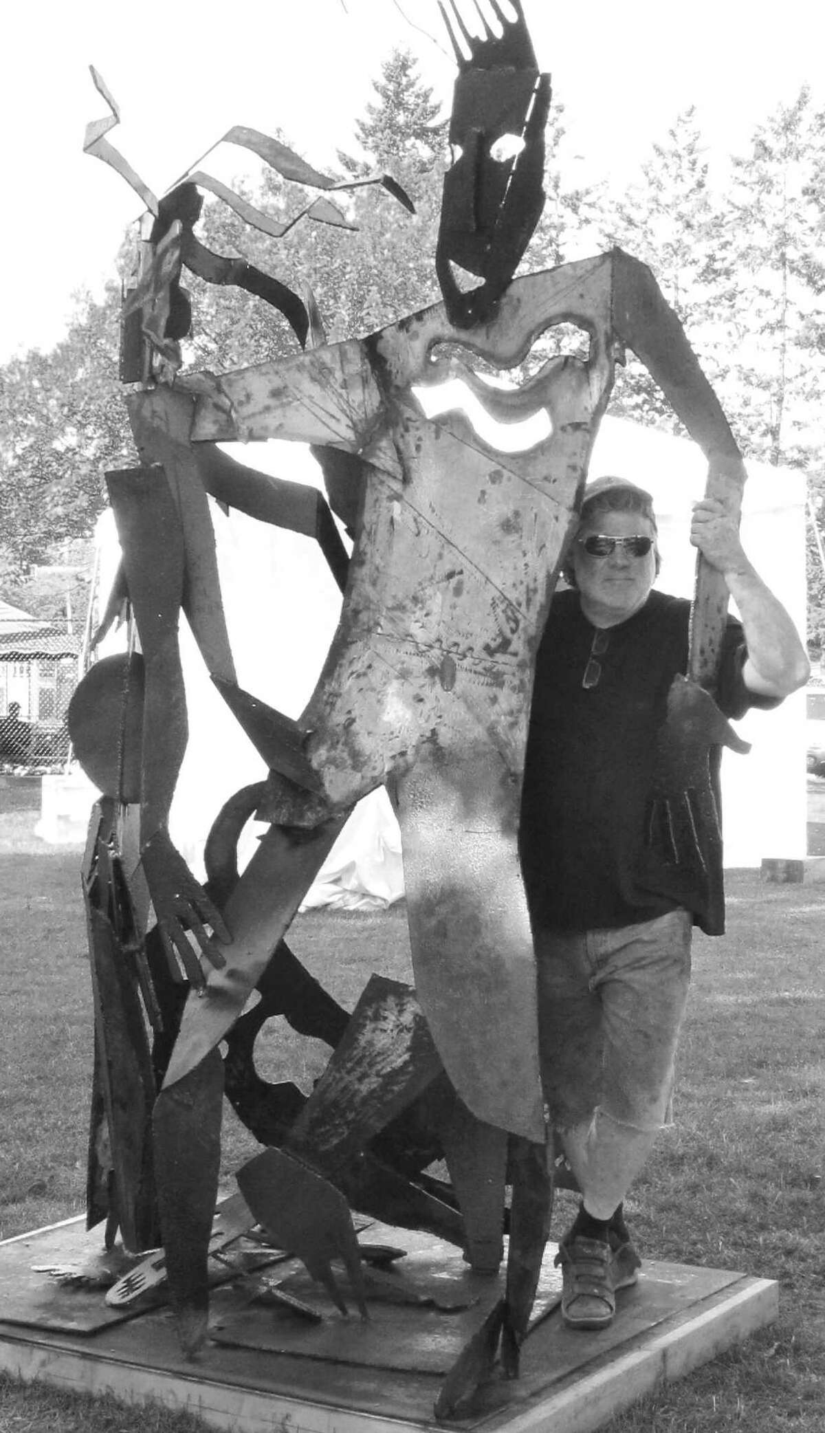 Lee Paine captures Swedish sculptor Kent Wahlbeck dancing with the devil at the recent Grassroots International Sculpture Symposium. Wahlbeck's creation,