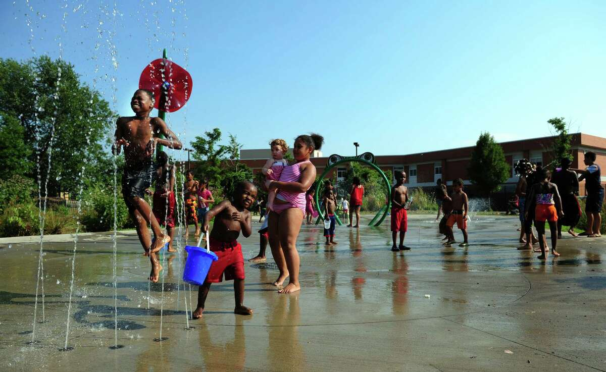 Children cool off in the splash pad at Luis Muñoz Marin Park in Bridgeport, Conn. Tuesday, July 17, 2012. The sprinkler park was partially funded by the Gathering of the Vibes festival which has been held at Seaside Park since 2007.