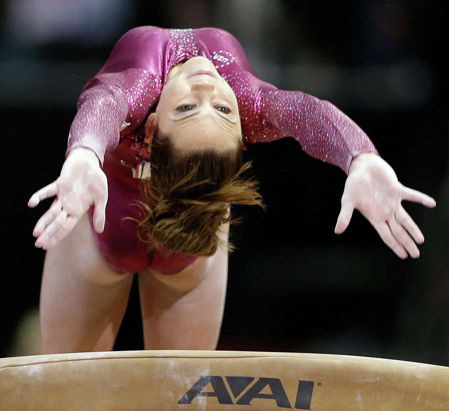 McKayla Maroney competes on the vault during the final round of the women's Olympic gymnastics trials, Sunday, July 1, 2012, in San Jose, Calif. Maroney was named to the U.S. Olympic gymnastics team.  (AP Photo/Gregory Bull) Photo: Gregory Bull, Associated Press / AP