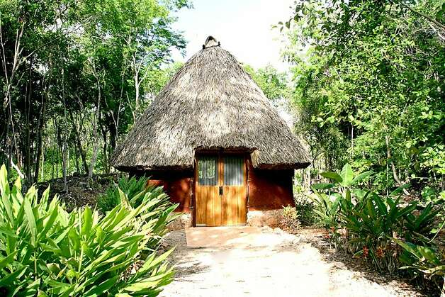 Pathways leading to Maya houses, each with its own theme. Photo: Ecomuseo Del Cacao