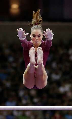 McKayla Maroney competes on the uneven bars during the final round of the women's Olympic gymnastics trials, Sunday, July 1, 2012, in San Jose, Calif. Maroney was named to the U.S. Olympic gymnastics team. (AP Photo/Gregory Bull) Photo: Gregory Bull, Associated Press / AP