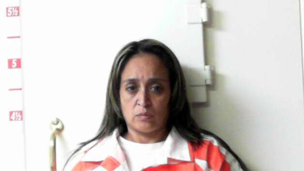 Leonora Maldonado Garcia, 39, of San Antonio, was arrested in Kimble County on July 14 after deputies found fraudulent driver's permits and checks in the car she was traveling in. She was charged with forgery, possession of fraudulent documents and engaging in organized crime. Photo: Courtesy