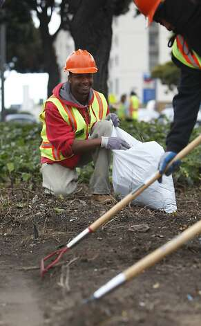 Seville Tollard (center), 19,  removes ivy from the median on Geary Boulevard along with others on his crew on Thursday, July 12, 2012 in San Francisco, Calif. Photo: Lea Suzuki, The Chronicle