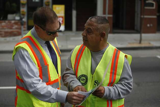 Dariush Kayhan (l to r), superintendent for Public Works, and Mitchell Salazar, workforce development director for Mission Neighborhood Centers, Inc. talk together as they look over paperwork on Thursday, July 12, 2012 in San Francisco, Calif. Photo: Lea Suzuki, The Chronicle