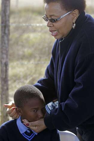 South Africa's Graça Machel interacts with a child at a party to celebrate former South African president Nelson Mandela birthday in Qunu, South Africa, Tuesday, July 17, 2012. South African's will celebrate former president Nelson Mandela's birthday tomorrow. (AP Photo/Schalk van Zuydam) Photo: Schalk Van Zuydam, Associated Press
