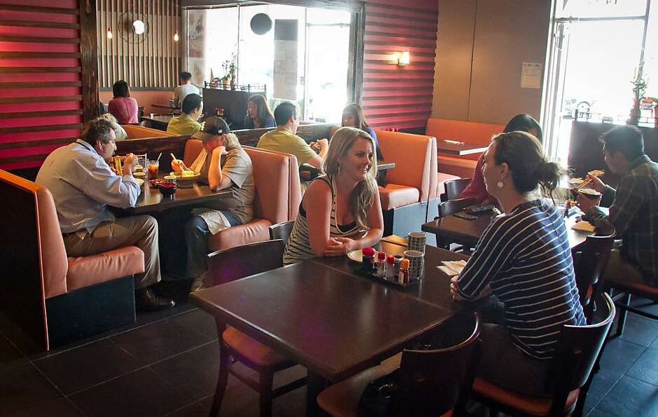 Patrons eat lunch at Ramen Taro in Foster City on July 12.