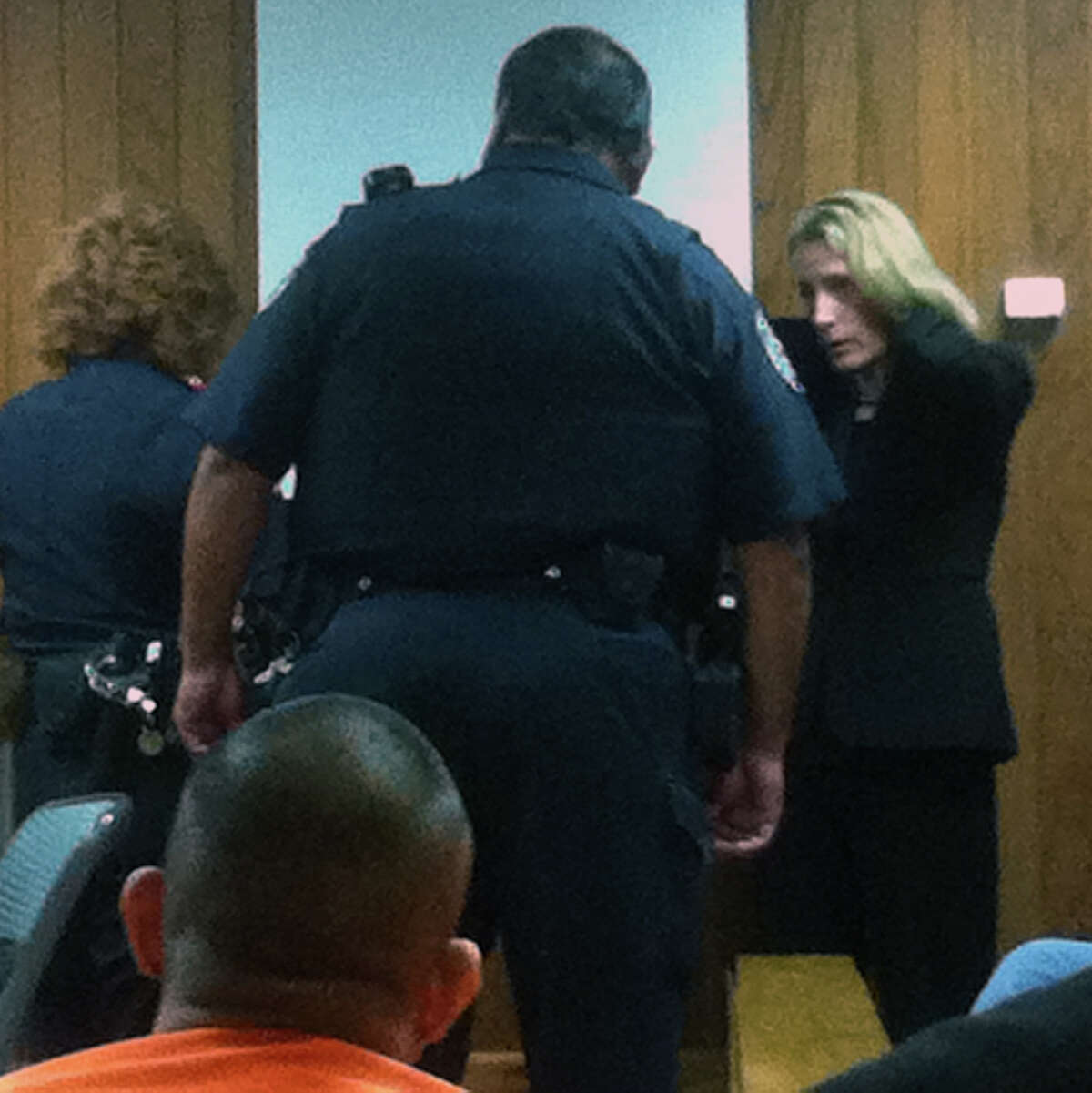 Intoxication assault convict Julie Ann Bronson takes off her jewelry Tuesday, July 17, 2012, after state District Judge Melisa Skinner ordered her to serve six months in jail as a condition of her probation.