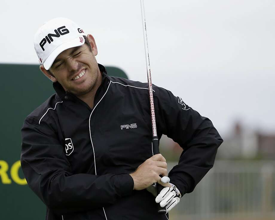 Louis Oosthuizen of South Africa reacts after playing a shot during a practice round at Royal Lytham & St Annes golf club ahead of the British Open Golf Championship, Lytham St Annes, England Tuesday, July  17, 2012. (AP Photo/Tim Hales) Photo: Tim Hales, Associated Press
