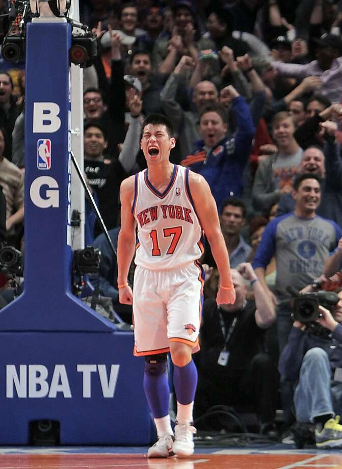 FILE - In this Feb. 19, 2012, file photo, New York Knicks' Jeremy Lin reacts during the second half of an NBA basketball game against the Dallas Mavericks in New York. Linsanity could be put to rest in New York when the clock strikes midnight. That's the deadline the Knicks face to match the daunting offer the Houston Rockets have made to Lin, the Harvard point guard who dazzled all of basketball for a brief stretch last season. (AP Photo/Seth Wenig, File) Photo: Seth Wenig, Associated Press