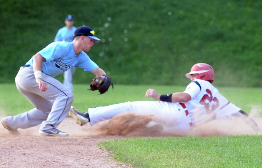 Stamford's Brandon Docimo tags Greenwich's Taylor Olmstead out at second as Greenwich hosts Stamford in a Senior American Legion Baseball game in Greenwich, Conn., July 17, 2012. Photo: Keelin Daly / Stamford Advocate