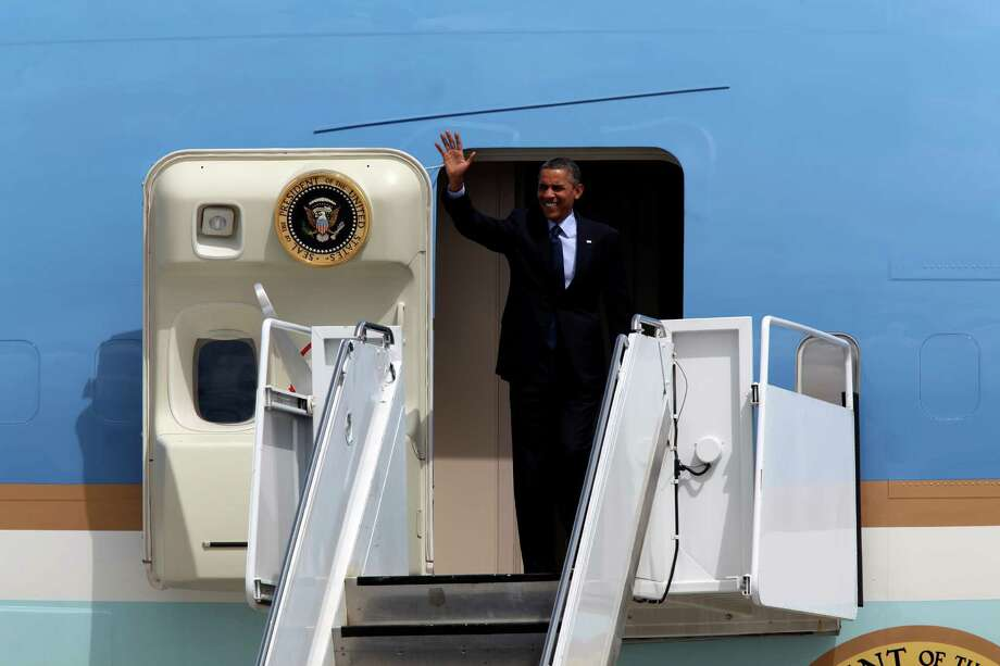 U.S. President Barack Obama greets guest and dignitaries upon his arrival at San Antonio International Airport, Tuesday, July 17, 2012. Obama is attending two fundraising events, one at the Convention Center and another one at a private residence in the Dominion. Photo: Jerry Lara, San Antonio Express-News / © 2012 San Antonio Express-News