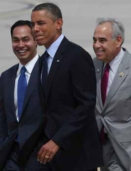U.S. President Barack Obama walks with Mayor Julian Castro and Rep. Charlie Gonzalez upon his arrival at San Antonio International Airport, Tuesday, July 17, 2012. Obama is attending two fundraising events, one at the Convention Center and another one at a private residence in the Dominion. Photo: Jerry Lara, San Antonio Express-News / © 2012 San Antonio Express-News