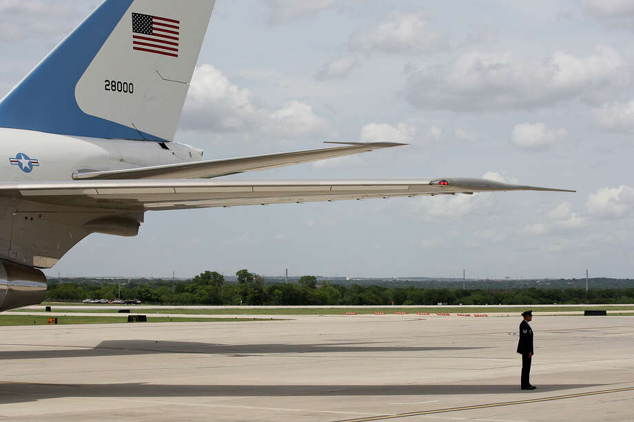 Personnel wait by Air Force One at San Antonio International Airport, Tuesday, July 17, 2012. President Barack Obama attended two fundraising events, one at the Convention Center and another one at a private residence in the Dominion. He was headed to Austin after his San Antonio trip. Photo: Jerry Lara, San Antonio Express-News / © 2012 San Antonio Express-News