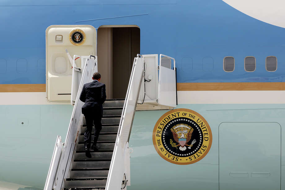 U.S. President Barack Obama trots up the ramp stairs as he boards Air Force One At San Antonio International Airport, Tuesday, July 17, 2012. Obama attended two fundraising events, one at the Convention Center and another one at a private residence in the Dominion. He was headed to Austin after his San Antonio visit. Photo: Jerry Lara, San Antonio Express-News / © 2012 San Antonio Express-News