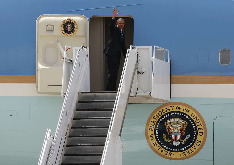 U.S. President Barack Obama waves as he boards Air Force One At San Antonio International Airport, Tuesday, July 17, 2012. Obama attended two fundraising events, one at the Convention Center and another one at a private residence in the Dominion. He was headed to Austin. Photo: Jerry Lara, San Antonio Express-News / © 2012 San Antonio Express-News