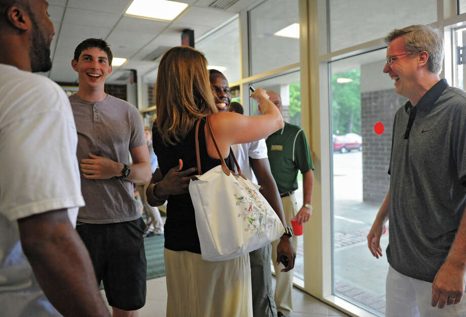 From left, former Siena basketball players Kenny Hasbrouck, Ryan Rossiter, and Ronald Moore are glad to see former coach Fran McCaffery, right, and his wife Margaret at the Siena Legends news conference and draft on Tuesday, July 17, 2012 in Loudonville, N.Y.  (Lori Van Buren / Times Union) Photo: Lori Van Buren