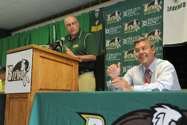 Siena head coach Mitch Buonaguro, left, makes a comment to reporter Roger Wyland at the Siena Legends news conference and draft on Tuesday, July 17, 2012 in Loudonville, N.Y.  (Lori Van Buren / Times Union) Photo: Lori Van Buren
