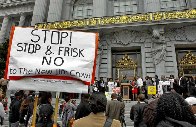 Dozens join a rally on the steps of City Hall San Francisco, Calif. on Tuesday July 17, 2012. A rally led by the Black Young Democrats of San Francisco, are calling on Mayor Ed Lee to put a stop to the controversial Stop and Frisk policing proposal. A petition containing 2,000 signatures was collected to show the opposition to the policy. Photo: Michael Macor, The Chronicle